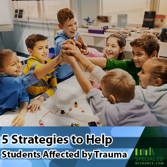 Group of students in the classroom all high fiving each other at the end of one of the 5 strategies the teacher implemented to help students affected by trauma.