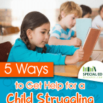 Young girl reading a book at her desk in school one of 5 Ways to Get Help for a Child Struggling With Reading