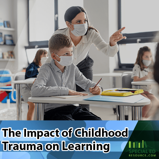 Teacher giving a student extra help in the classroom after realizing the impact of childhood trauma on learning.