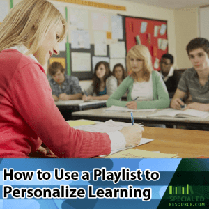 Teacher sitting at her desk in front of her classroom full of students going over how to use a playlist to personalize learning.