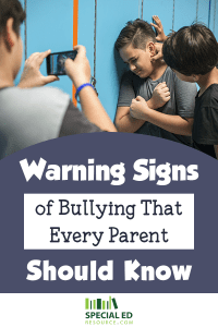 Group of boys bullying one boy at school. Read the warning signs of bullying that every parent should know.