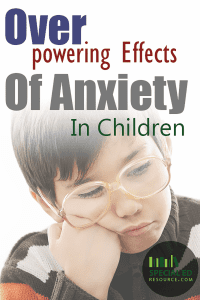 "Sad young boy with glasses with text overlay ""Overpowering Effects Of Anxiety In Children"""