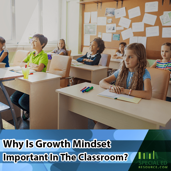Elementary classroom of students sitting at their desks while their teacher does a growth mindset activity
